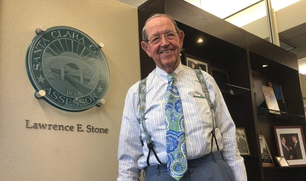 Man standing in front of County of Santa Clara seal