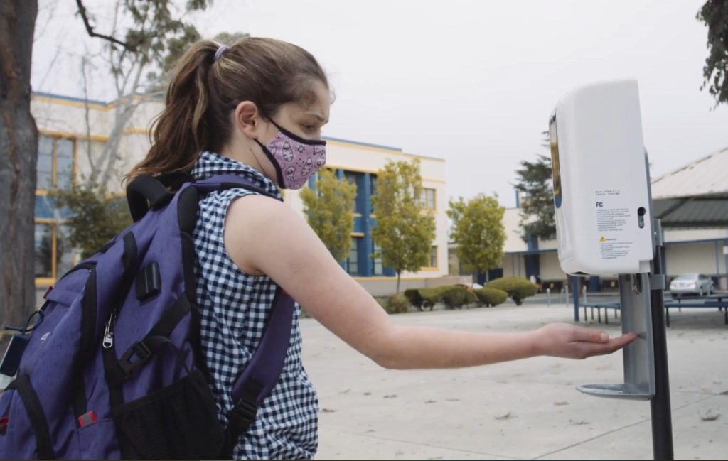 Wearing masks, hand sanitizing and keeping six feet apart are required for returning San Jose Unified School District students. Photo courtesy of SJUSD.