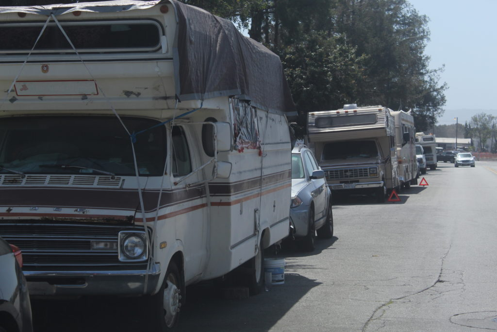 RVs line Parrott Street in San Jose, taking up parking spaces near businesses. Photo by Vicente Vera.