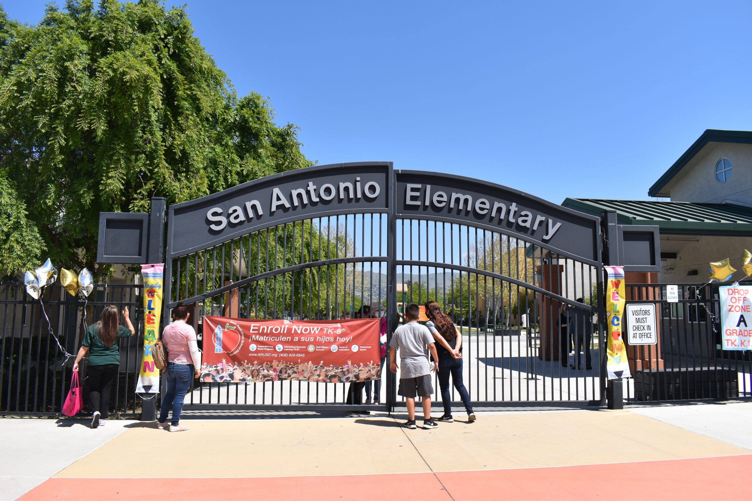Students eager for school to reopen peek through the gate at San Antonio Elementary School, an Alum Rock Union School District campus. Photo by Lorraine Gabbert.